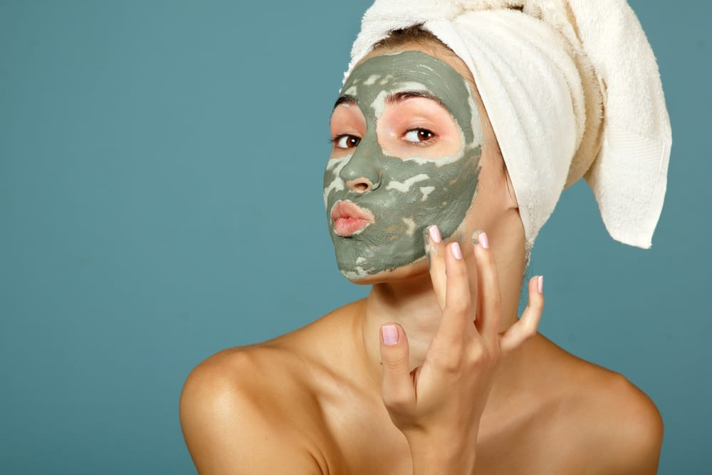 Girl putting on face mask