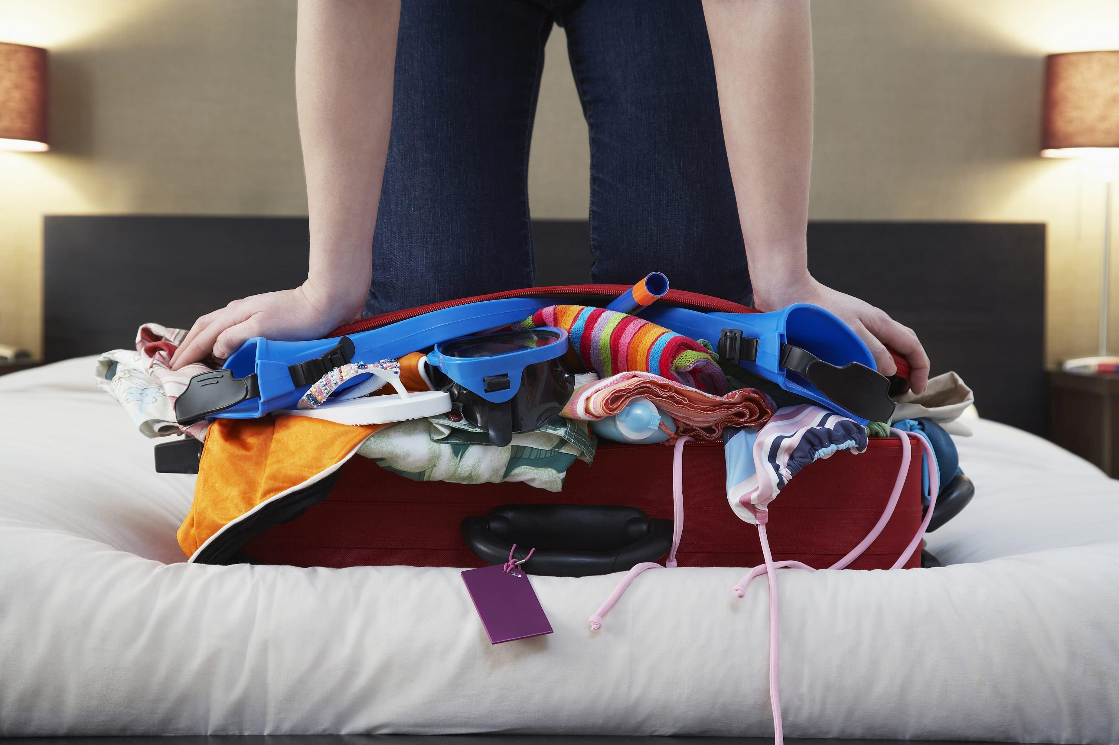 w14-1-Overstuffed Suitcase