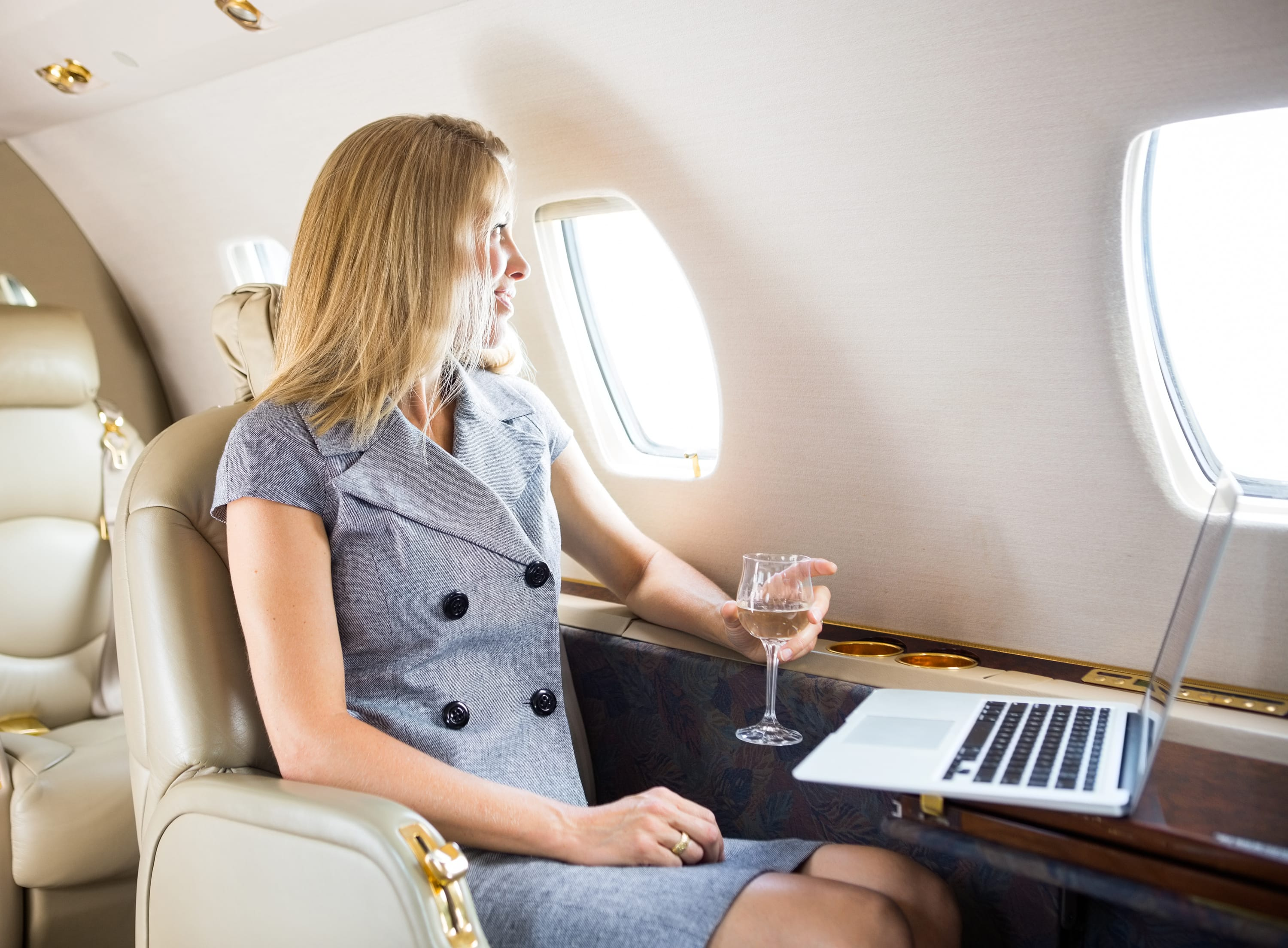 w20-4-Woman sitting in first class