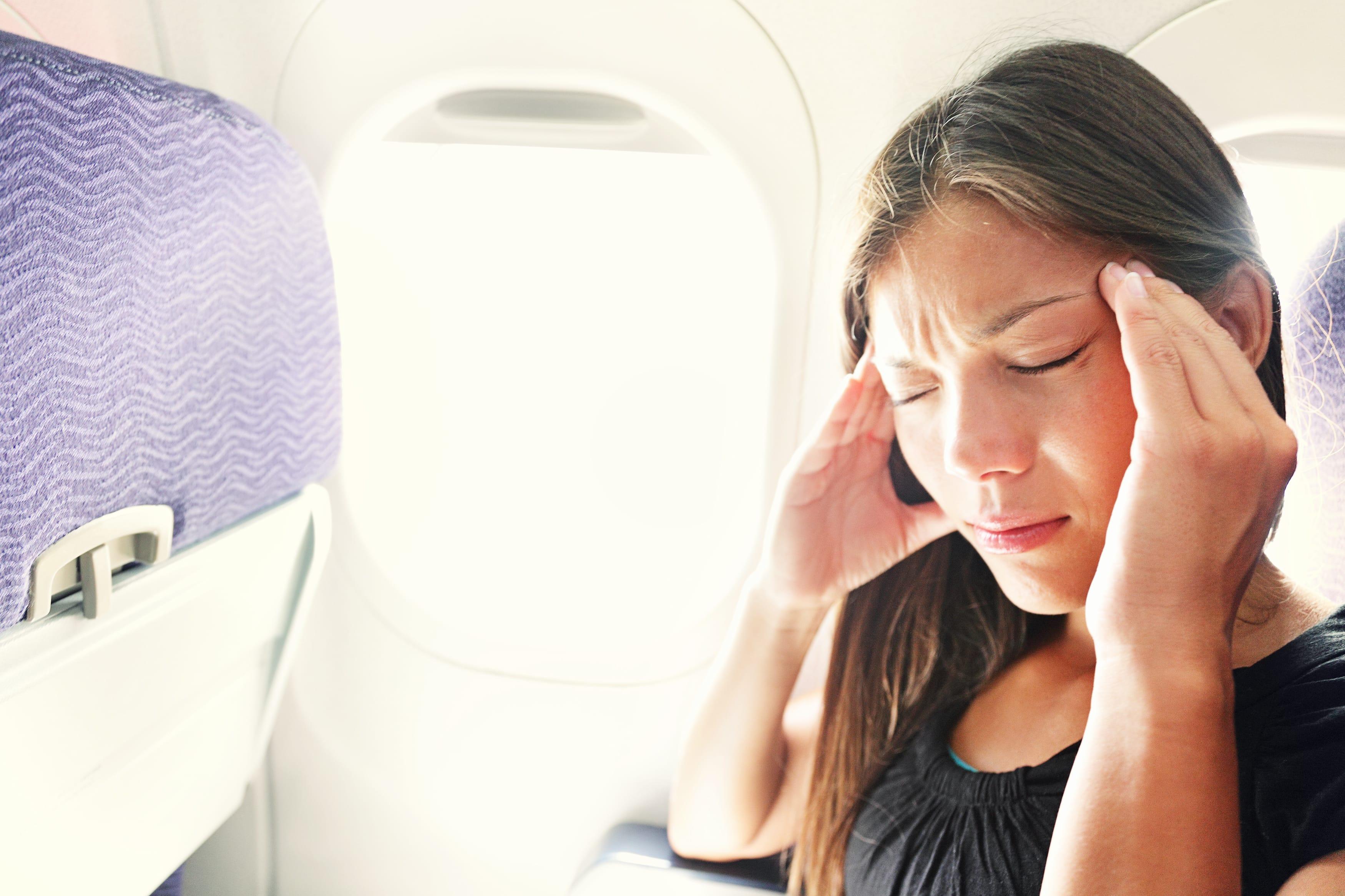 w22-2-Girl with a headache on a plane