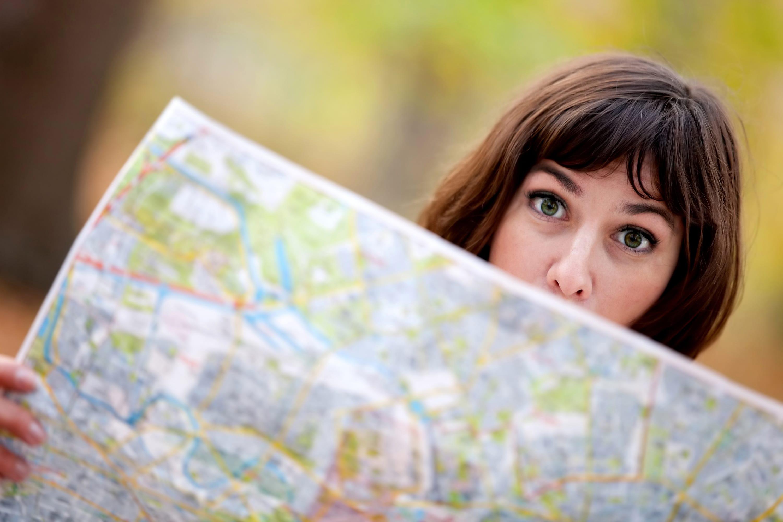w24-3-Girl hiding behind map