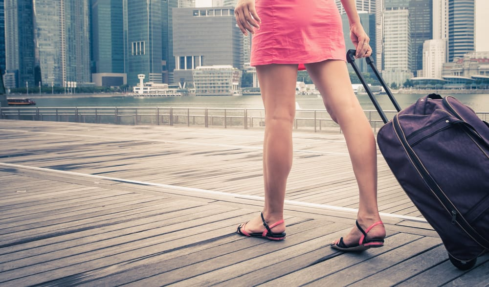 tourist or woman adventure with luggage in Singapore